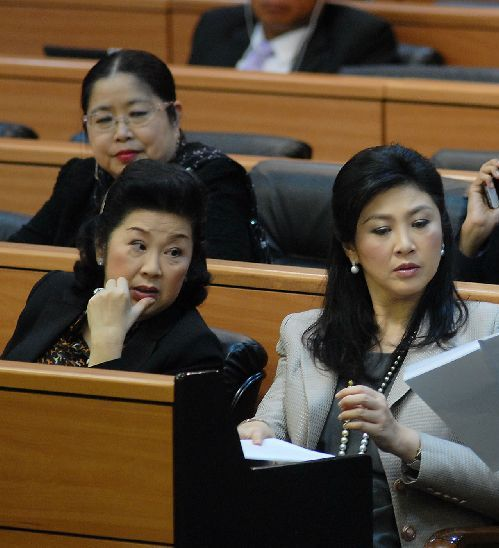 Yingluck joined the debate for the first time as an MP, sitting next to her sister, Ms. Yaowapa Wongsawat, another big player in the Shinawatra clan
