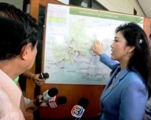 Prime Minister Yingluck Shinawatra looks over possible flood area's