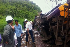 Rescue workers and the injured at the site of a Bangkok-Chiang Mai express service train derailment in Phrae province