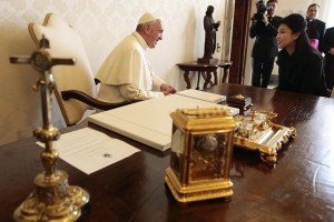 Pope Francis, left, talks with Thai Prime Minster Yingluck Shinawatra during a private audience at the Vatican on Thursday