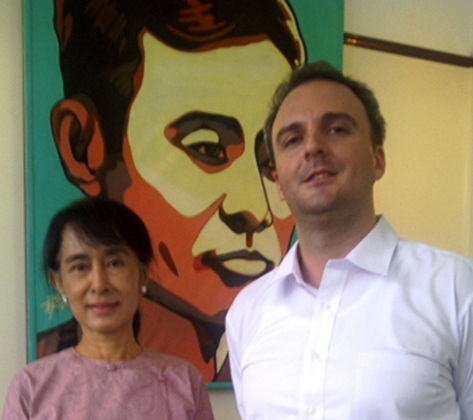 British labor right activist Andy Hall with Burmese opposition leader Aung San Suu Kyi. Hall has investigated numerous labor rights abuses against Burmese migrant workers in Thailand