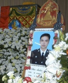 The family paid 3 million baht ($93,100) to the dead policeman's siblings in a deal aimed at avoiding a civil lawsuit.