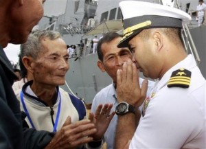 "Dec. 3, 2010, U.S. navy officer Michael ""Vannak Khem"" Misiewicz, right, greets his relatives at Cambodian coastal international see port of Sihanoukville, about 220 kilometers (137 miles) southwest of Phnom Penh,  Photo/Heng Sinith) Cambodia"