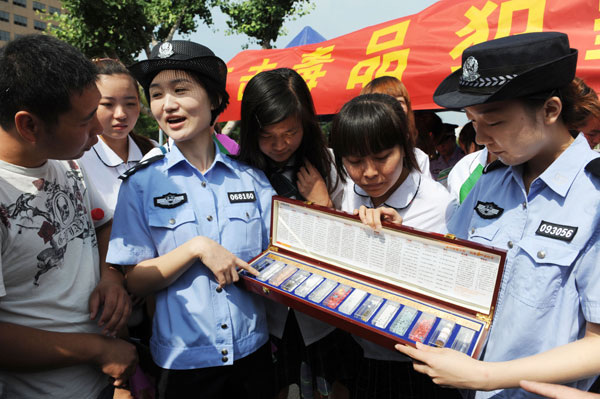 People in Bozhou, Anhui province, receive a lesson on narcotics from the police as part of a local anti-drug campaign in June. The number of China's registered drug addicts has doubled in the last five years.