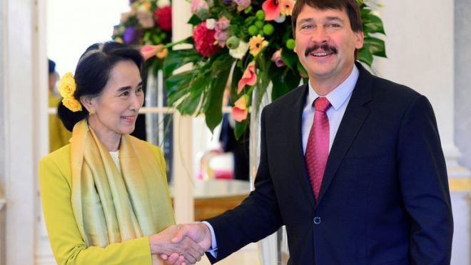 Myanmar's opposition leader Aung San Suu Kyi (L) is welcomed by the Hungarian President Janos Ader at Buda Castle in Budapest