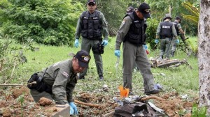 Thai policemen inspect the site of a bomb attack in Thailand's restive southern province of Yala.