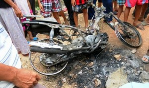 Motorcycle burnt by Locals