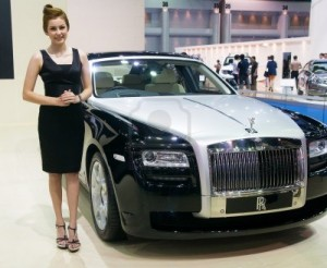 A representative from Rolls Royce shows their Rolls Royce Ghost