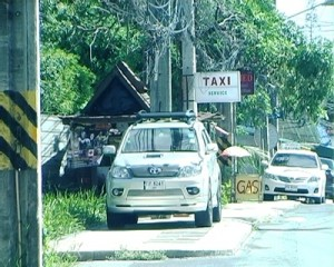 the taxi intrusively hawk their service to foreign tourists and charge them extortive fare later