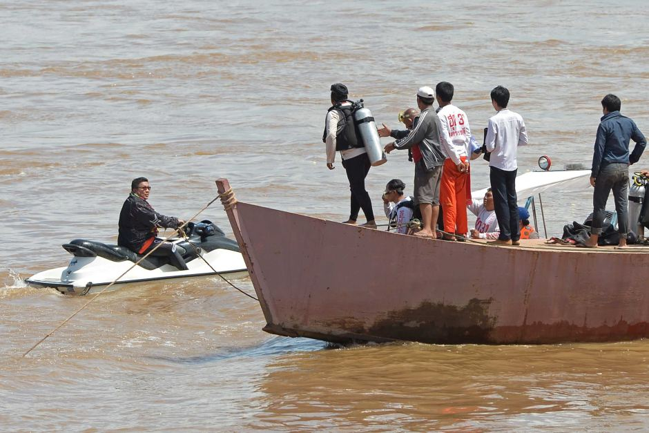 Divers are searching the Mekong River for bodies after Wednesday's plane crash.