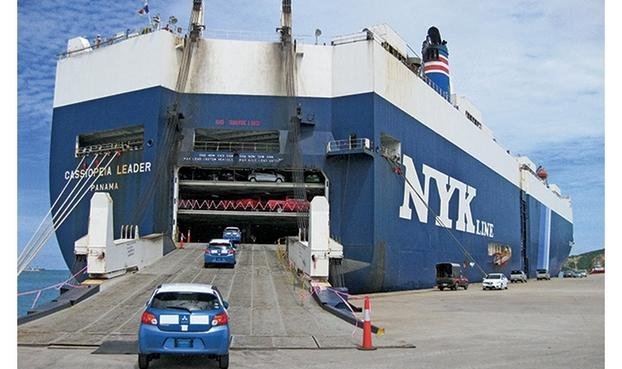 Mitsubishi Mirage hatchbacks are loaded onto a transport ship for export to the United States