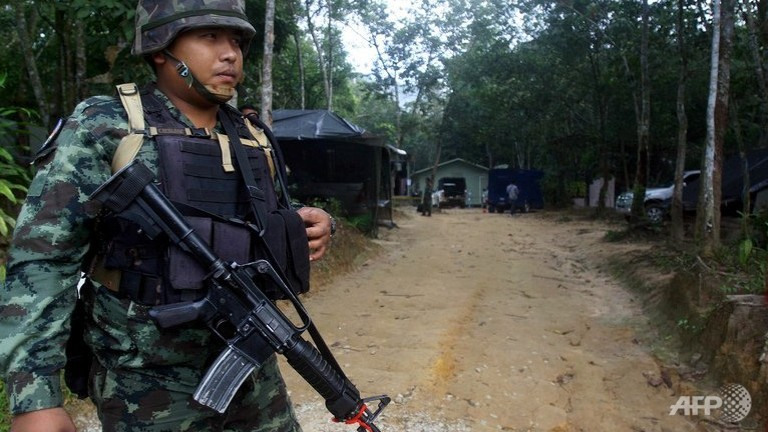 Thai soldier standing guard at the entrance to a military camp in Thailand's restive southern province of Narathiwat