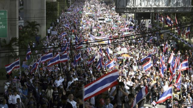 Anti-government demonstrators fill up a street during a rally in Bangkok, Thailand,