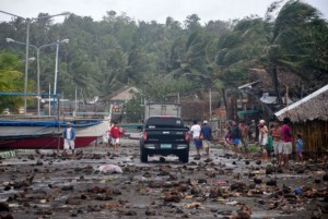 Debris litters the road by the coastal village in Legazpi city following a storm surge brought about by powerful Typhoon Haiyan in Albay province