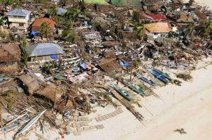 An aerial view shows damaged houses on a coastal community, after Typhoon Haiyan hit Iloilo Province, central Philippines November 9, 2013