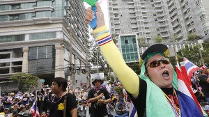 Thousands of pro and anti-government demonstrators mass in Bangkok.