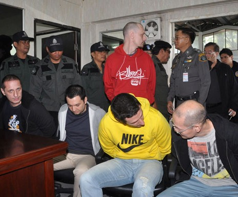 Two Brits, one Slovak, one Filipino and one Taiwanese man were extradited from Thailand to the US to face drug charges on Tuesday. (Photo by Wasssayos Ngamkham)
