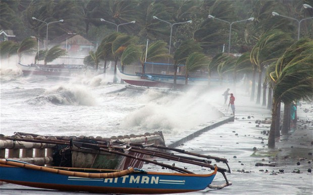 High waves pound the sea wall as strong winds from Typhoon Haiyan hit the city of Legaspi, Albay province, south of Manila Photo: Charism Sayat/AFP/Getty Images