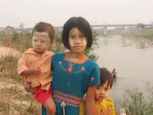 Burmese children on the Thai side of the border with the Friendship Bridge in the background