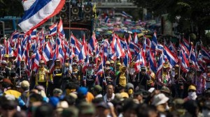 Demonstrators also massed outside the headquarters of Prime Minister Yingluck Shinawatra's Puea Thai party, setting up a tense standoff with riot police guarding the building.