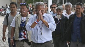 Urging intervention: Protest leader Suthep Thaugsuban, centre, with supporters at a meeting with armed forces in Bangkok Read more: http://www.smh.com.au/world/thai-military-backs-elections-despite-links-to-opposition-20131215-hv5sk.html#ixzz2nXsETFcc