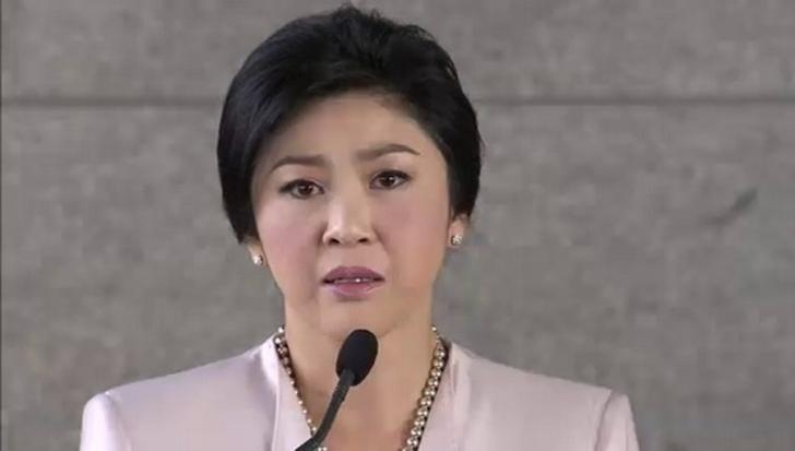 Tearful PM seeks justice for her Shinawatra family
