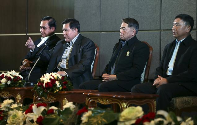 Thailand Supreme Commander of armed forces Gen. Thanasak Patimaprakorn, second left, along with three service chiefs, addresses a press conference after a meeting with anti-government protest leader Suthep Thaugsuban, in Bangkok, Thailand