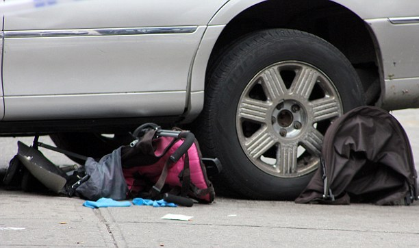 The stroller slid underneath the car and Noraisah Wae-Useng fell out, sustaining serious injuries on her head.- Stock Photo