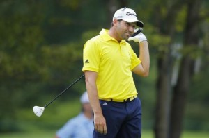 Sergio Garcia of Spain watches his tee shot on the fourth hole