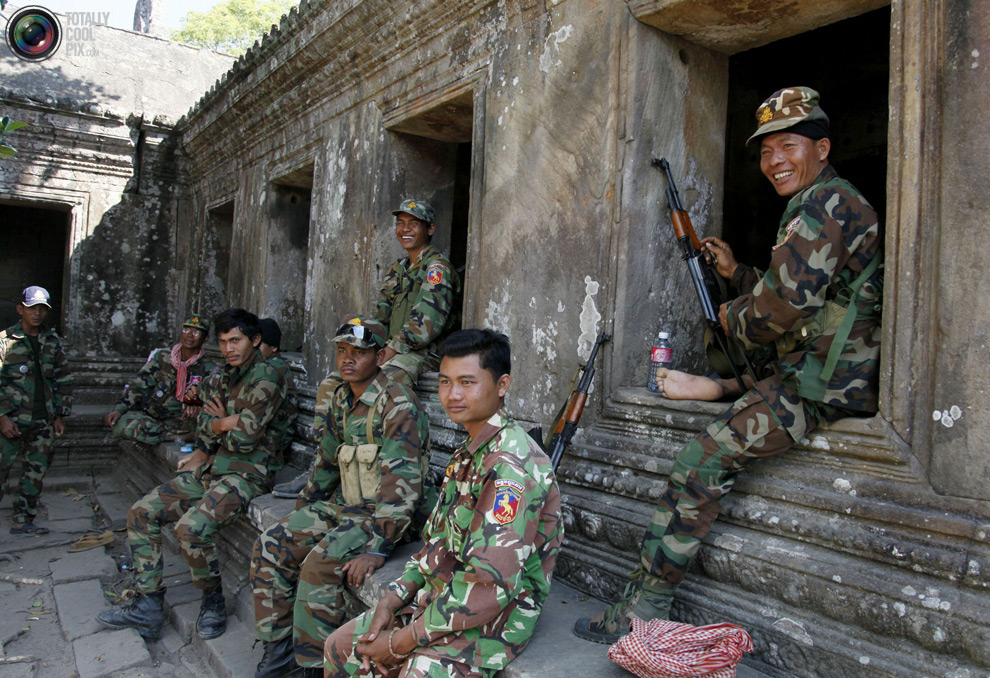 Cambodian soldiers sit at Preah Vihear temple