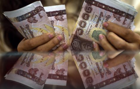 Baht Drops to a Three-Year Low, Stocks Drop on Political Unrest