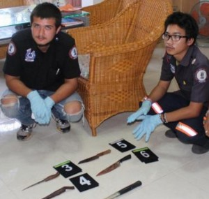 Rescue workers found several blood-stained knives and a pound hammer at the scene. Photo: Kritsada Mueanhawong