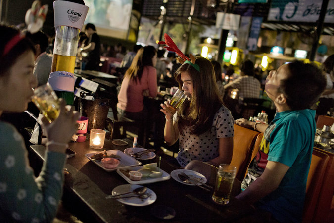 People drank Chang beer at a bar in Udon Thani, Thailand, in January