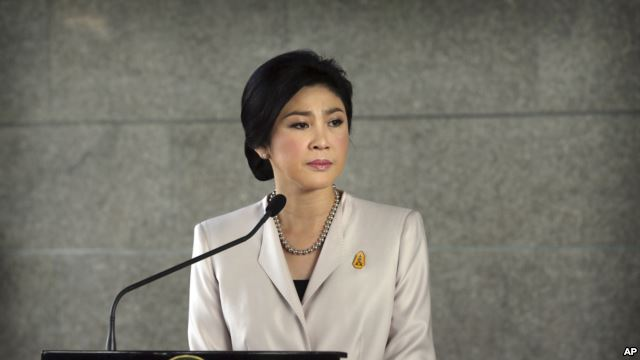 FILE - Thailand Prime Minister Yingluck Shinawatra pauses as she talks to media after attending a Cabinet meeting, in Bangkok.