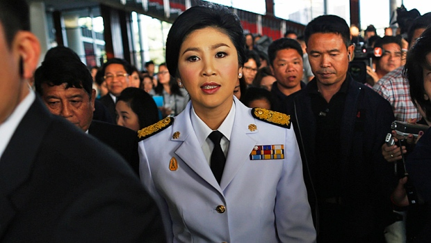 Thailand's Iron Lady? Prime Minister Yingluck Shinawatra leaves the Army Club after meeting the Election Commission in Bangkok on Tuesday. The commission wanted to postpone Sunday's vote but she overruled them.