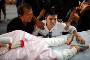 Thayakorn Yosubon, father of two young children killed in a bomb blast near an anti-government protest site in Bangkok on Sunday, at the funeral for the kids on Monday