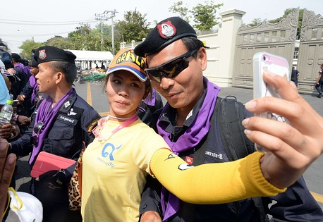 "Anti-government protesters in Thailand have been snapping tons of ""selfies"" with their smartphones and uploading them on Instagram"