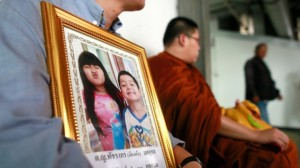 Tayakorn Yos-ubon, left, the father of two children killed in Sunday's bomb attack on an anti-government protest site, holds their portrait as he waits with a monk for their bodies at a hospital in Bangkok Read more: http://www.ctvnews.ca/world/un-urges-child-free-protest-zones-after-2-kids-die-1.1700954#ixzz2uLMkIPlX