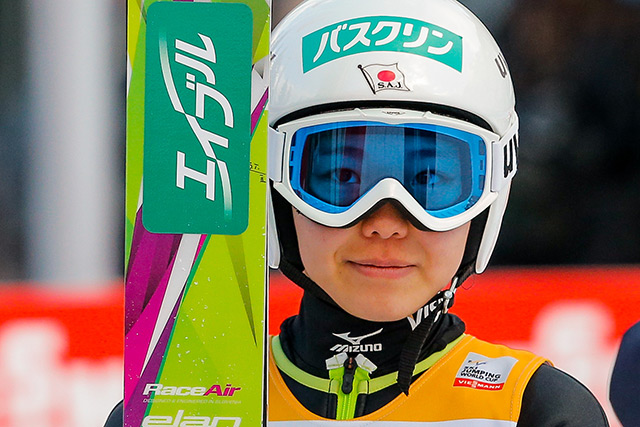 Sara Takanashi poses proudly after taking second place at FIS Ski Jumping World Cup Women's HS95 on January 25, 2014 in Planica, Slovenia. (Stanko Gruden/Agence Zoom/Getty Images)
