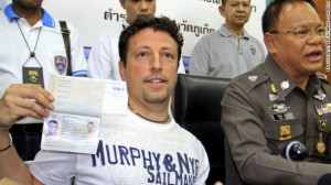 Italian tourist Luigi Maraldi, who had reported his passport stolen in August 2013, shows his current passport during a press conference at a police station in Phuket island, Thailand, on March 9.