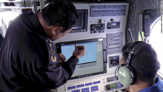 Malaysian coast guard personnel checking a radar screen during search and rescue operations for the missing Malaysia Airlines flight on March 9.
