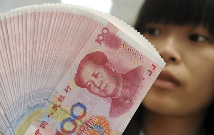 China Doubles Yuan Trading Band