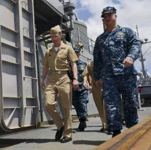 Captain Mark Benjamin( Right), commanding officer of the submarine tender USS Frank Cable