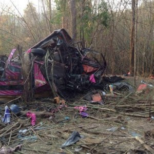 The wrecked double-decker bus that plunged into a ravine, killing 30 passengers and injuring 22 more, in Tak on Monday night, March 24 2014. (Photo by Assawin Pinijwong