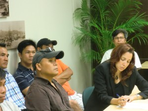 Thai laborers speak to the media with one of their civil attorneys, Clare Hanusz