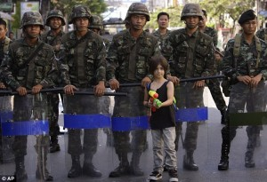 Soldiers drive their tanks on the road in Bangkok as protests grow over 'rigged' elections. Thai Soldiers. Caught on camera: 7 year old Apple Rozas