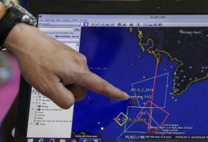 A map of a flight plan is seen on a computer screen during a meeting before a mission to find the Malaysia Airlines flight MH370 that disappeared from radar