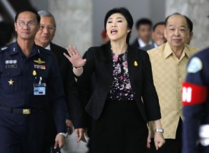 Thailand's Prime Minister Yingluck Shinawatra gestures as she leaves the Royal Thai Air Force Headquarters, after a cabinet meeting in Bangkok