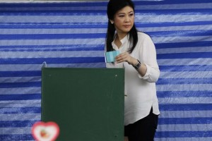 Thai Prime Minister Yingluck Shinawatra prepares to cast a ballot at a polling station in Bangkok