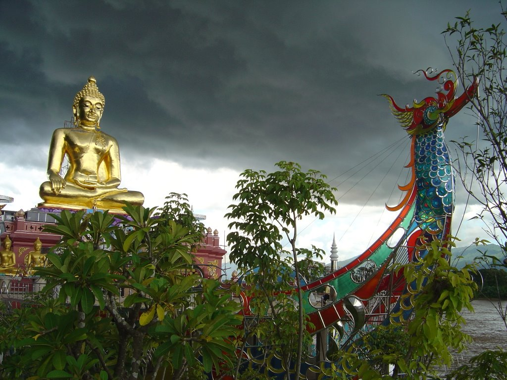 Buddha at the golden triangle Thailand shortly before thunderstorm